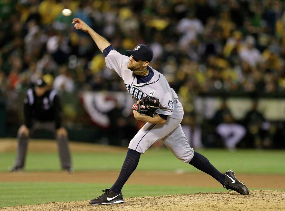 Seattle Mariners' Tom Wilhelmsen works against the Oakland Athletics in the ninth inning of a baseball game Monday, April 1, 2013, in Oakland, Calif. Photo: AP