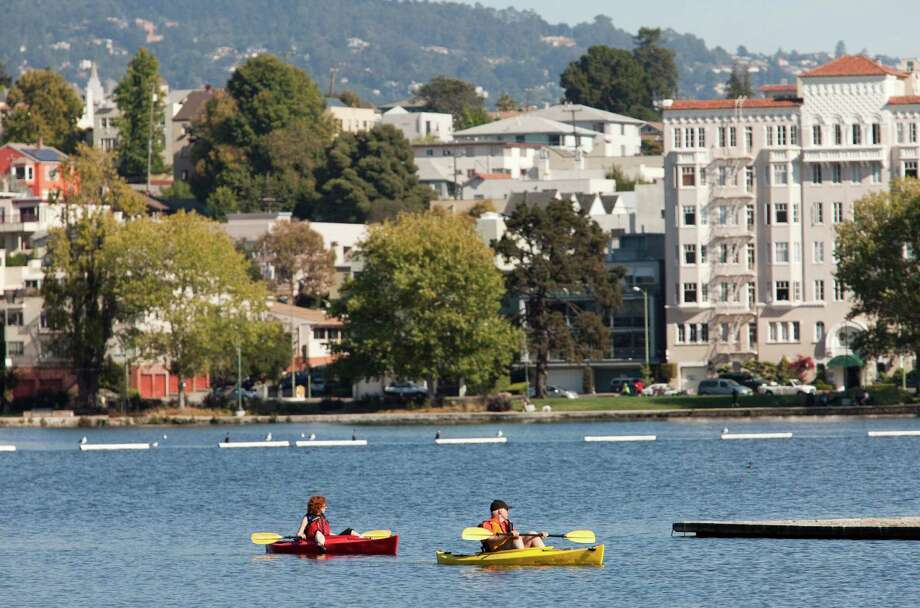 Lake Merritt has turned you into a birder, runner, walker, sailor, tai chi master, lounger and not a swimmer. Photo: Tomas Ovalle, Special To The Chronicle / SFC