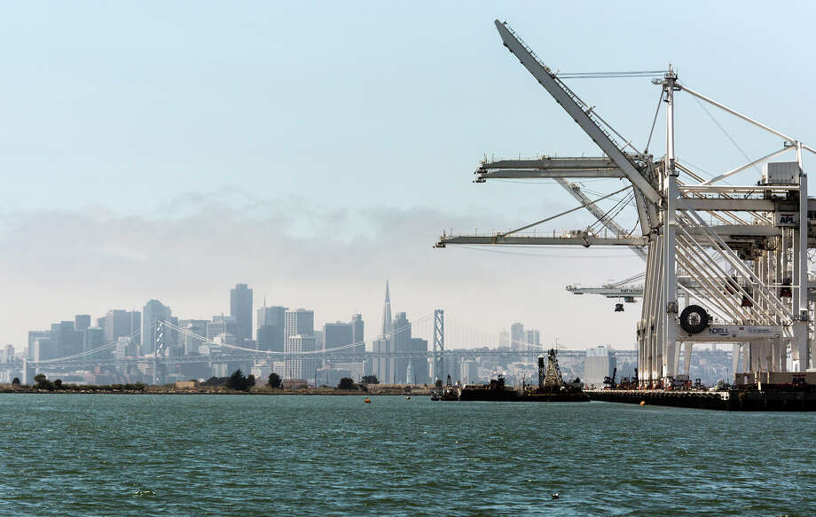 You're proud to tell a visitor the legend that the port of Oakland cranes inspired the creation of AT-AT walkers in the Empire Strikes Back. (Even though it is just a legend). Photo: Ken James, Bloomberg / © 2012 Bloomberg Finance LP