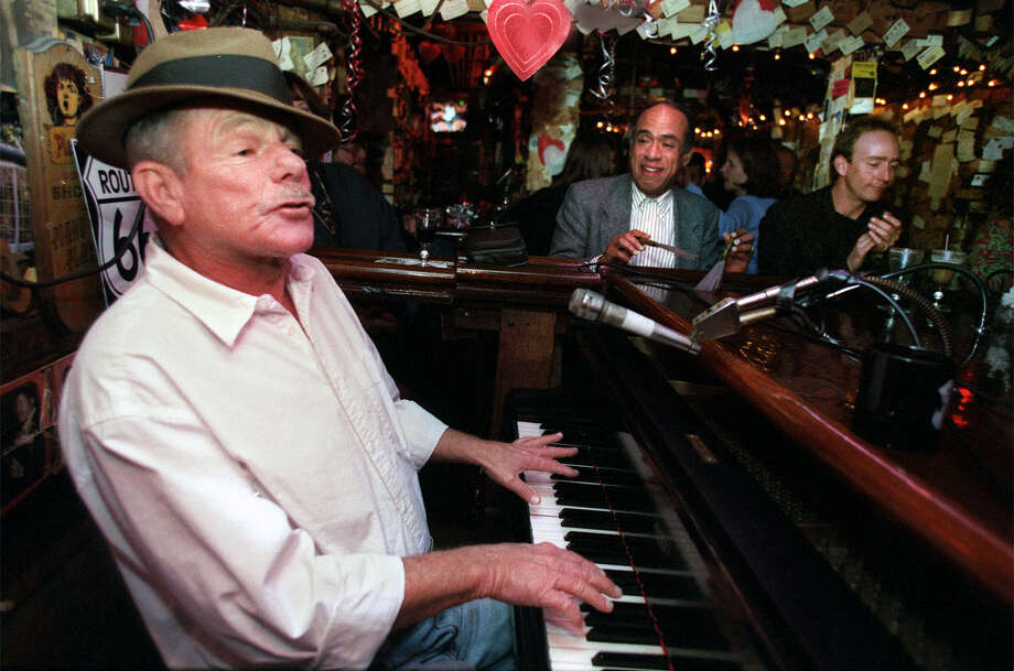 Your business card is wallpaper where you karaoke to Rod Dibble at the piano (The Alley). Photo: LIZ HAFALIA, SFC / SAN FRANCISCO CHRONICLE