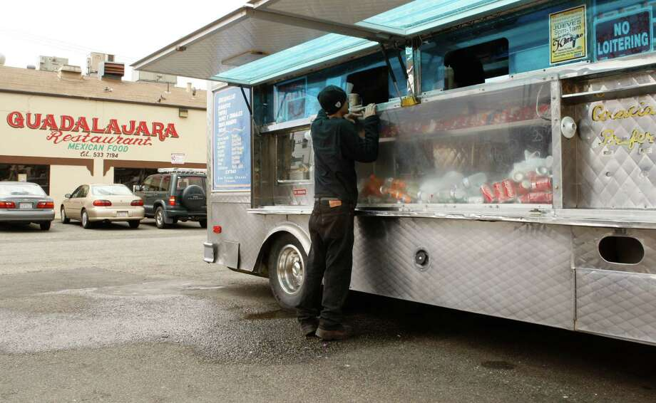 You go taco truck hopping on International. Photo: Alex Washburn, The Chronicle / SFC
