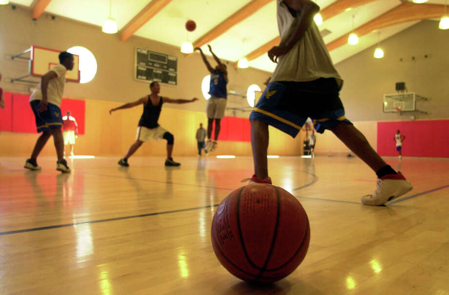 You know a great baller from either the Soldiers or the Rebels (youth basketball teams). Photo: PAUL CHINN, SFC / CHRONICLE