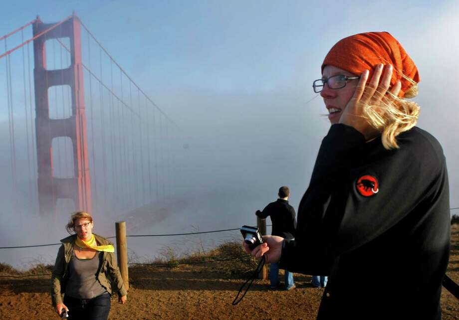 Hand earmuffs to your visiting tourists before walking across the Golden Gate Bridge. Photo: Lacy Atkins, The Chronicle / SFC
