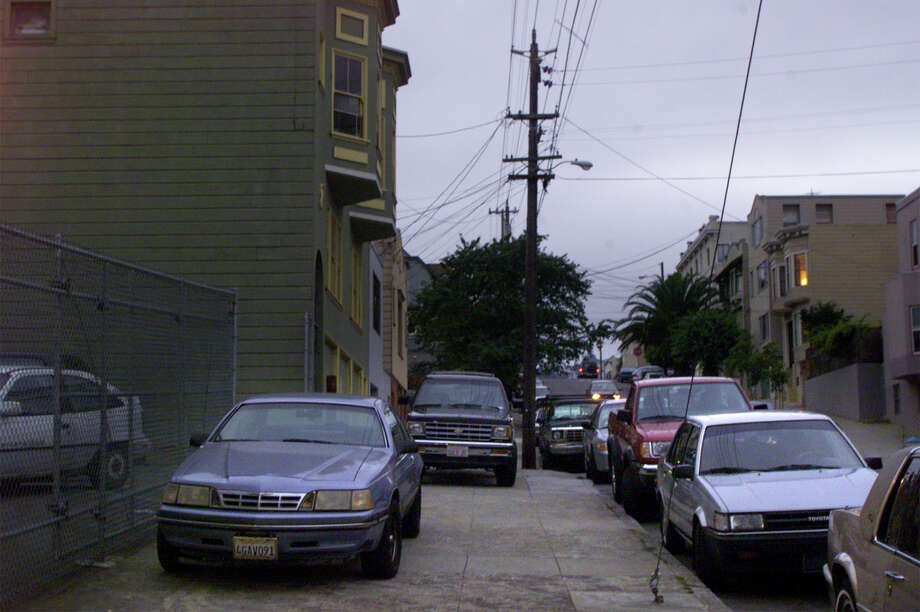 Park your car on the sidewalk at the exact moment the street cleaner passes so you can move back into your primo street parking and prevent the drivers chasing the cleaner from stealing your spot. Photo: LIZ HAFALIA, SFC / CHRONICLE