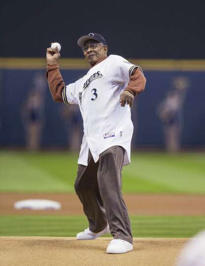 MILWAUKEE, WI - APRIL 1: James Beckum throws out the ceremonial first pitch before the start of the