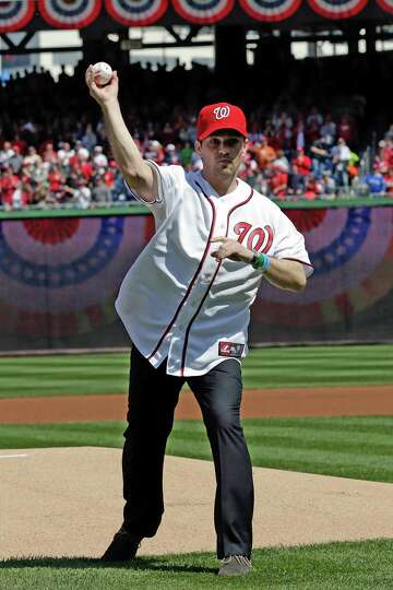 WASHINGTON, DC - APRIL 01:  Medal of Honor winner Clint Romeha throws out the first pitch before the