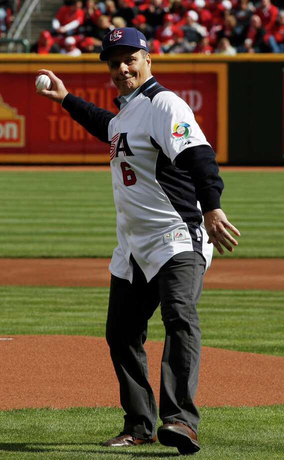 Joe Torre throws out the ceremonial first pitch prior to a major league baseball game between the Cincinnati Reds and the Los Angeles Angels, Monday, April 1, 2013, in Cincinnati. (AP Photo/David Kohl) Photo: David Kohl, Associated Press / FR51830 AP