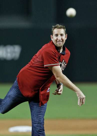 Former Arizona Diamondbacks Cy Young Award winning pitcher Brandon Webb throws out the first pitch p