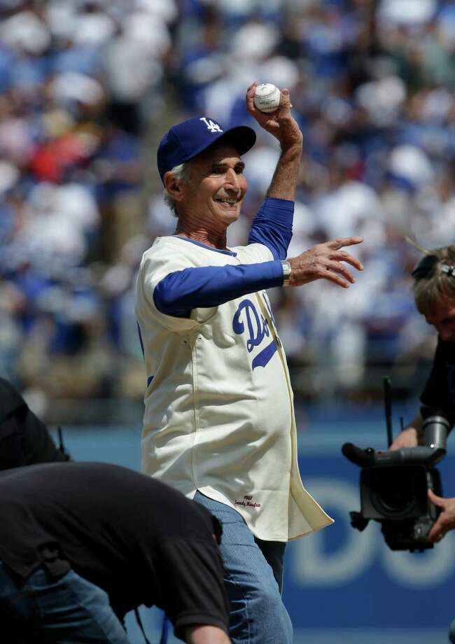 Former Dodger pitcher Sandy Koufax throws the ceremonial first pitch before a season-opening baseball game between the Los Angeles Dodgers and the San Francisco Giants in Los Angeles, Monday, April 1, 2013. (AP Photo/Jae C. Hong) Photo: Jae C. Hong, Associated Press / AP