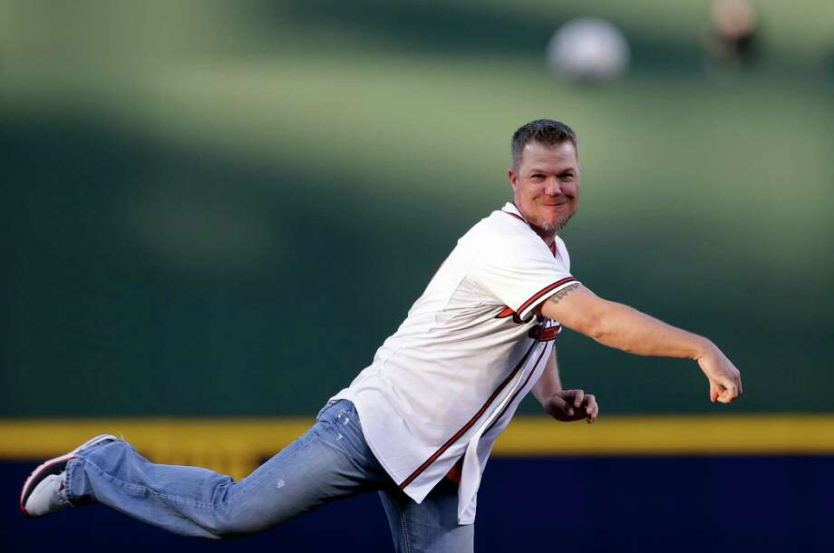 Former Atlanta Braves third baseman Chipper Jones throws out the first pitch for an opening day baseball game between the Braves and the Philadelphia Phillies, Monday, April 1, 2013, in Atlanta. (AP Photo/David Goldman) Photo: David Goldman, Associated Press / AP