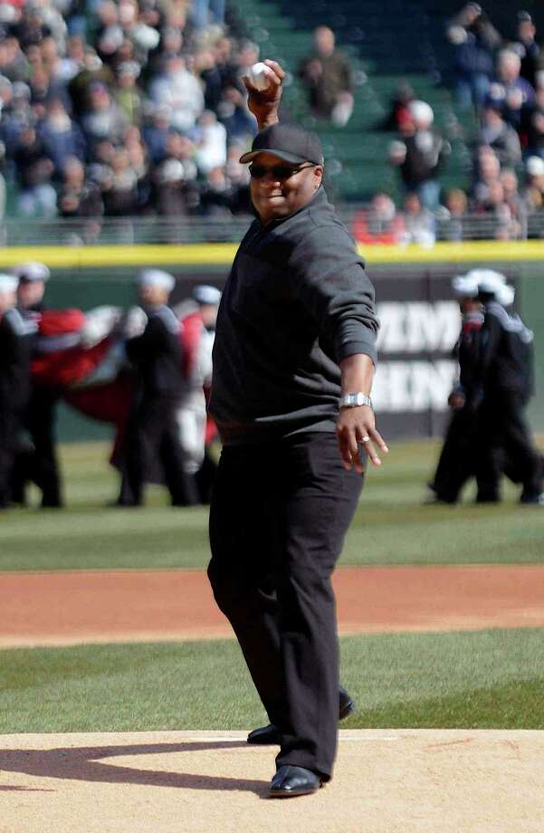 Former Chicago White Sox and Kansas City Royals player Bo Jackson throws out the ceremonial first pitch of their opening day baseball game in Chicago on Monday, April 1, 2013. (AP Photo/Daily Herald, John Starks) Photo: John Starks, Associated Press / Daily Herald