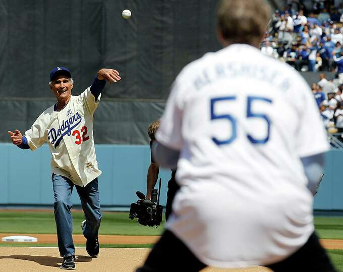 Los Angeles Dodgers pitching legend Sandy Koufax throws out the first pitch during the season opener