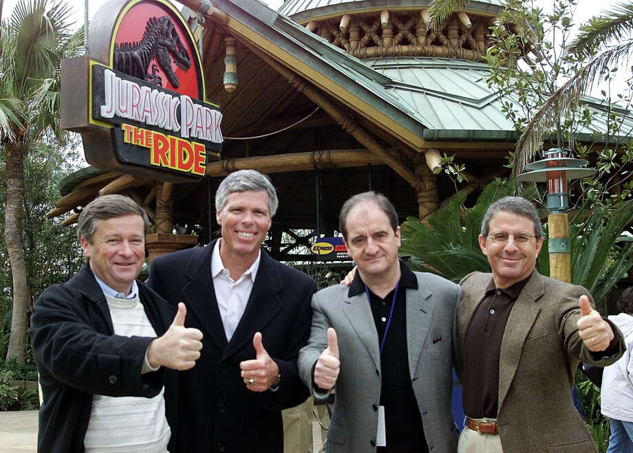 (From left) Vivendi Universal Chairman and CEO Jean-Marie Messier, Universal Studios Recreation Group Chairman and CEO Thomas William,  Canal+ Chairman and CEO  Pierre Lescure and Universal Studios President and Chief Operating Officer Ron Meyer give the thumbs up in front of the 'Jurassic Park' ride attraction during a preview of Universal Studios Japan in Osaka on March 30, 2001. Photo: TOSHIFUMI KITAMURA, AFP/Getty Images / AFP