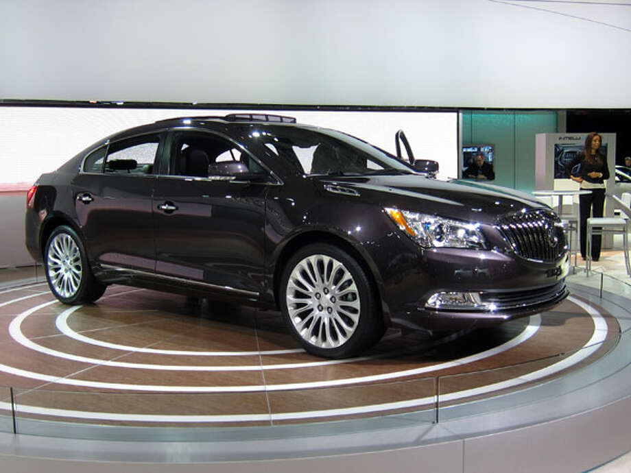 Buick LacrosseBuick's big sedan gets updated styling for 2014, with a new grille that features active aerodynamic shutters. A new interior features an 8-inch reconfigurable instrument cluster display and a larger 8-inch infotainment screen. The Lacrosse can now also be had with many of the safety features found on the Cadillac XTS (which, like the new Chevy Impala, shares the same platform), such as adaptive cruise control and a vibrating seat that alerts the driver with the blind-spot and lane departure warnings. Photo: Popular Mechanics