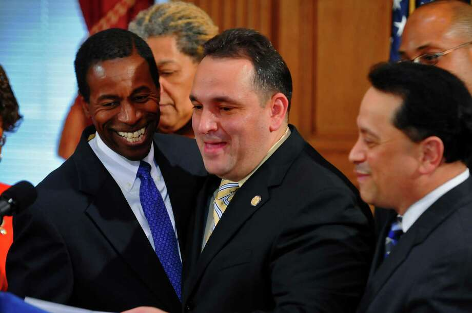 Breakaway Democratic state Sen. Pedro Espada Jr., right, was welcomed back to the fold by Democratic leader Malcolm Smith, left, and fellow Democrats, including Sen. Hiram Monserrate, center,  on July 9, 2009, at the Capitol in Albany. Espada was named majority leader, while Smith became president pro tempore. ( Philip Kamrass  /  Times Union) Photo: PHILIP KAMRASS, ALBANY TIMES UNION / 00004691A