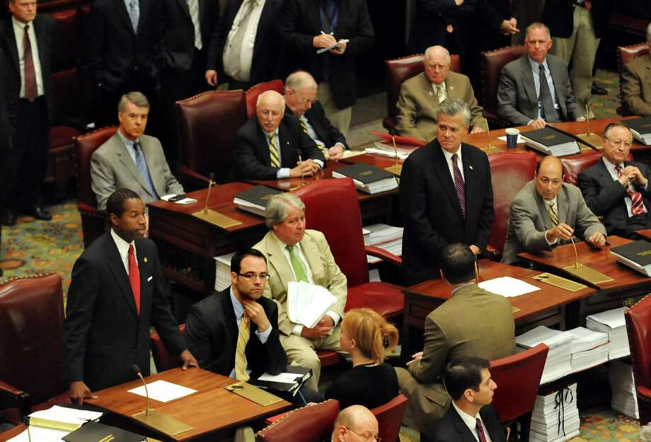 Sen. Malcolm Smith, left, and Sen. Dean Skelos, right, stand as Smith speaks during the Senate's extraordinary session on Wednesday, July 1, 2009, at the state Capitol in Albany, N.Y. Skelos quickly adjourned the session. (Cindy Schultz / Times Union) Photo: CINDY SCHULTZ, ALBANY TIMES UNION / 00004570A