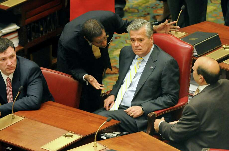 Sen. Malcolm Smith, left, talks with Sen. Dean Skelos, right, when the Republicans join Democrats in the Senate Chamber on Tuesday, June 30, 2009, at the state Capitol in Albany, N.Y. (Cindy Schultz / Times Union) Photo: CINDY SCHULTZ, ALBANY TIMES UNION / 00004546A