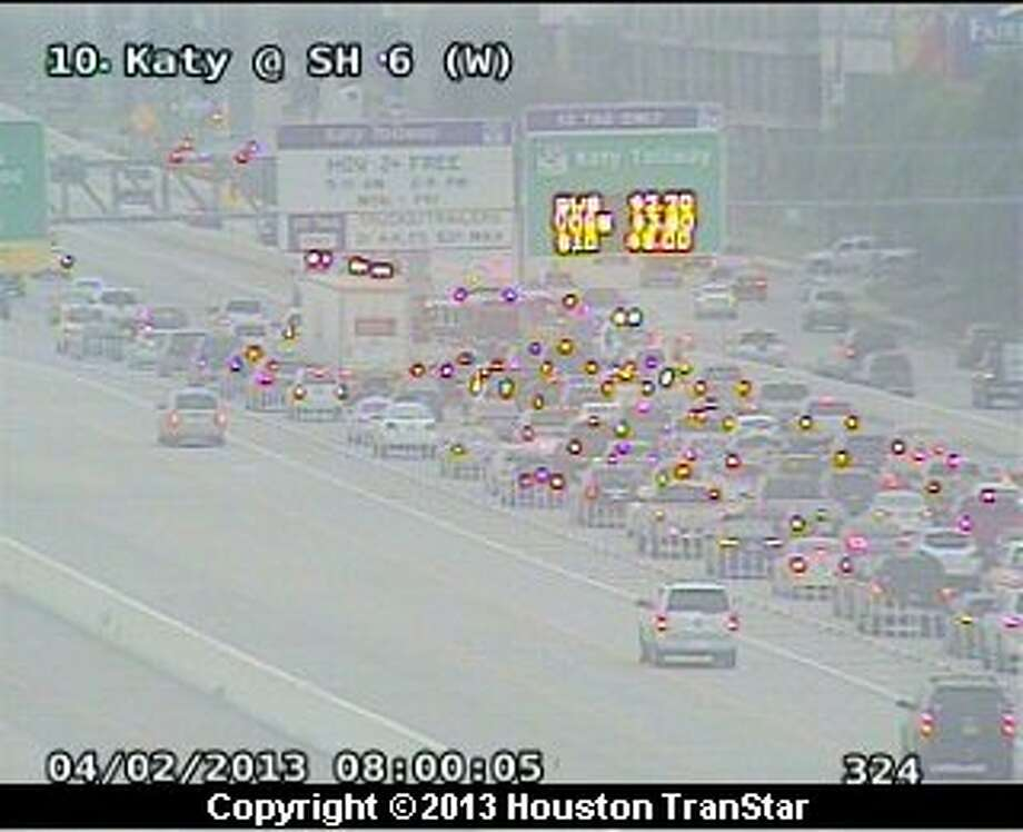 Traffic was backed up on the eastbound Katy Freeway near Highway 6 after a five-car pileup during rush hour Tuesday morning. Photo: Houston Transtar