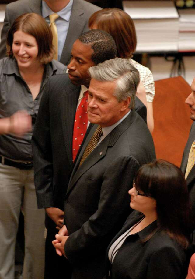 Senate Democratic leader Malcolm Smith, left, and Senate GOP leader Dean Skelos, right, pose for a photo after a special session July 6, 2009. Photo: Times Union
