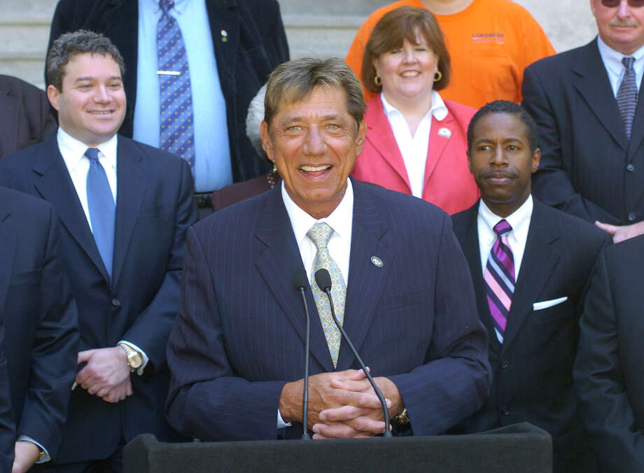 Joe Namath, center, backed by New York state legislators, speaks in favor of the proposed New York Sports and Convention Center during a rally at the Capitol in Albany, N.Y. Monday, May 9, 2005.  At left is Assemblyman Jonathan Bing, D-New York City, and at right are Assemblywoman Susan John, D-Rochester, and state Sen. Malcolm Smith, D-Queens. Photo: TIM ROSKE, AP / AP