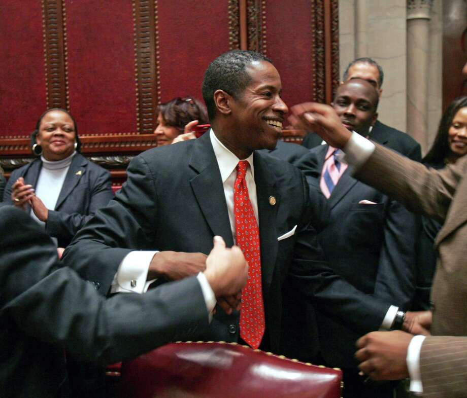 Sen. Malcolm Smith, D-Queens, greets well-wishers in the Senate chamber after being elected majority leader at the Capitol in Albany, N.Y., on Jan. 7, 2009. Photo: Mike Groll, AP / AP