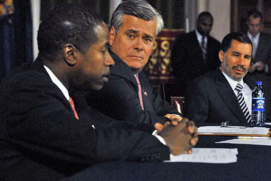 Senate Majority Leader Dean Skelos, center, and Gov. David Paterson, right, listen to Senate Minority Leader Malcolm Smith,  left, during a contentious legislative leaders meeting to discuss the state's fiscal crisis, in the Capitol in Albany on Tuesday, November 18, 2008. (PHILIP KAMRASS/TIMES UNION) Photo: PHILIP KAMRASS, ALBANY TIMES UNION / 00001304A