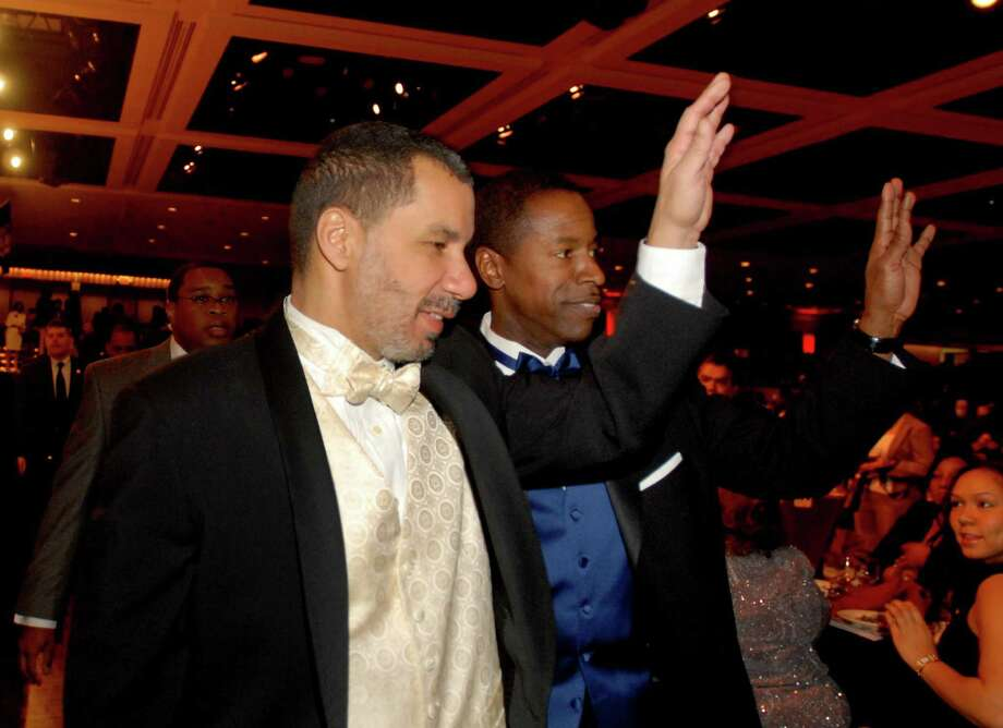 Gov. David Paterson approaches the stage as the keynote speaker and one of the 2009 Trailblazer Award recipients at the 38th annual Black and Puerto Rican Legislators Caucus Weekend at the Empire State Plaza Convention Center in Albany on Feb. 15, 2009. Senate Majority Leader Malcolm Smith, left, was also a Trailblazer Award winner. Photo: LMF, ALBANY TIMES UNION / 00002457A