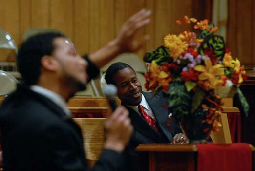 "Senate Majority Leader Malcolm Smith, right, watches as Ryan  Key of Newport News, Va., left, sings ""I Love You Lord Today."" Smith had picked him out of the audience and asked him to sing, during the NACP Founders Day program at the Union Missionary Baptist Church in Albany, on March 1, 2009.  This was the 100th anniversary of the group. Smith was the guest speaker. (Philip Kamrass / Times Union) Photo: PHILIP KAMRASS, ALBANY TIMES UNION / 00002633A"