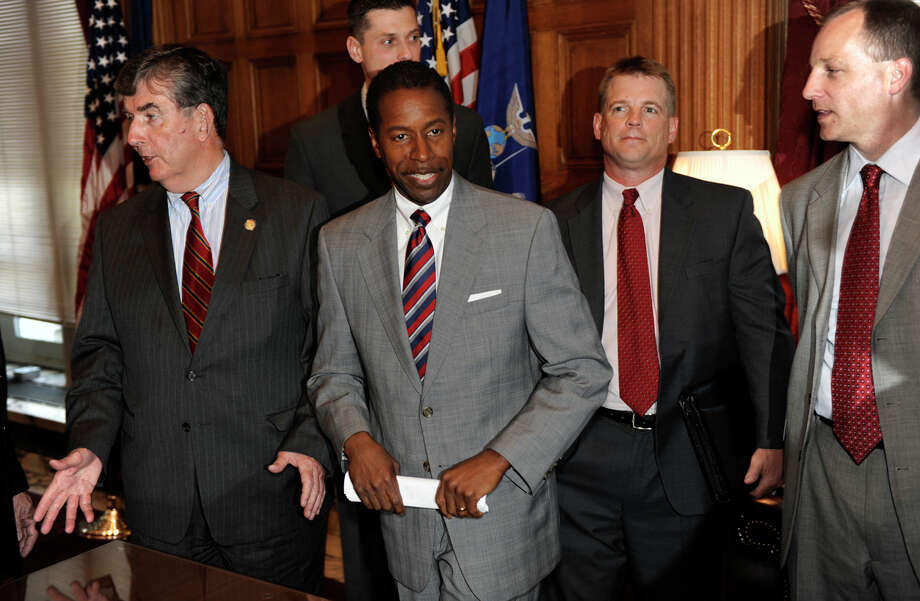 Senate Majority Leader Malcolm Smith, center, is surrounded by fellow senators after speaking at a news conference in the Capitol in Albany on May 11, 2009, about the potential revamping of the Empire Zone Program. Photo: SKIP DICKSTEIN, TIMES UNION
