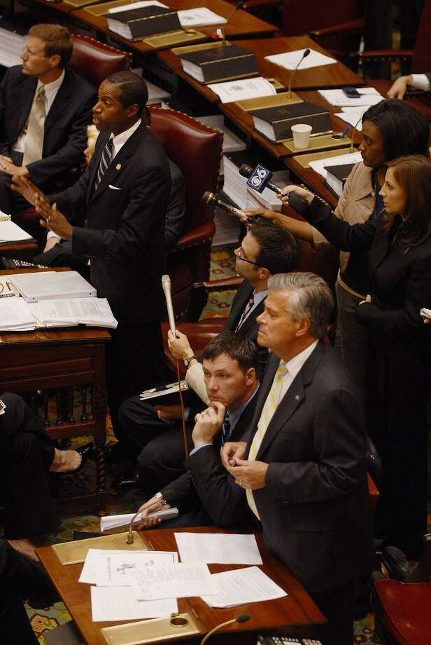 Sen. Malcolm Smith, standing top left, and Sen. Dean Skelos, standing bottom right, address their respective presiding officers during Senate session  at the Capitol in Albany on June 23, 2009.   (Paul Buckowski / Times Union) Photo: PAUL BUCKOWSKI, ALBANY TIMES UNION