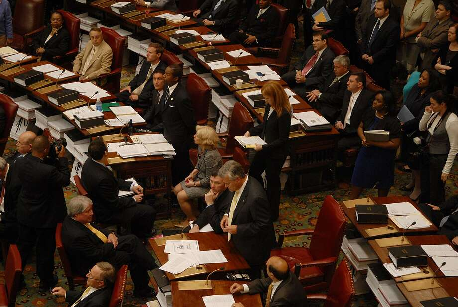 Sen. Malcolm Smith, standing top, and Sen. Dean Skelos, standing bottom, address their respective presiding officers during Senate session  at the Capitol in Albany on June 23, 2009.   (Paul Buckowski / Times Union) Photo: PAUL BUCKOWSKI, ALBANY TIMES UNION