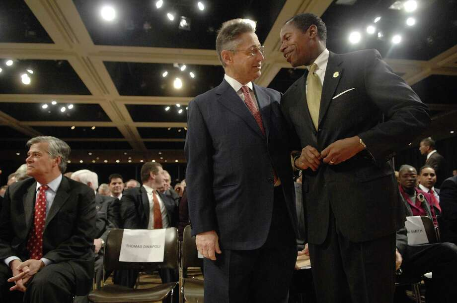Assembly Speaker  Sheldon Silver, foreground left, talks with Senate Minority Leader Malcolm Smith, with Senate Majority Leader Dean Skelos in the background left, as they waited for Gov. David Paterson to give his budget address  at the Empire State Plaza Convention Center in Albany on Tuesday, Dec. 16, 2008.  The governor is releasing his budget earlier than previous governors to start the conversation with legislators as they try to close projected deficit in the billions of dollars. (PAUL BUCKOWSKI/TIMES UNION)  Photo: PAUL BUCKOWSKI, ALBANY TIMES UNION / 00001687A