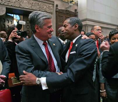 Sen. Dean Skelos, R-Rockville Centre, left, hugs Sen. Malcolm Smith, D-Queens, as Smith arrives in the Senate Chamber at the Capitol in Albany, N.Y., Wednesday, Jan. 7, 2009.  Smith succeeds Skelos as majority leader in the Senate. Photo: Mike Groll, AP / AP