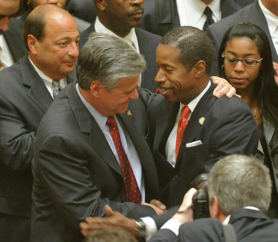 Former Majority Leader Dean Skelos, left, congratulates Malcolm Smith, right, who was voted the majority leader of the state Senate at the Capitol in Albany on January 7, 2009. Photo: SKIP DICKSTEIN, TIMES UNION / 00001919C