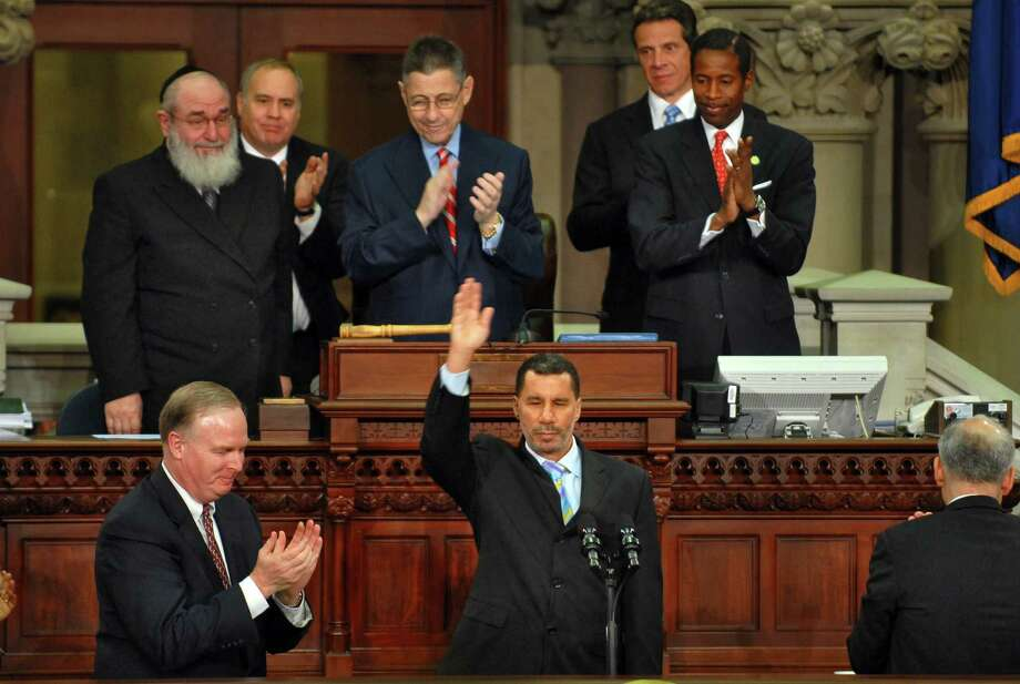 Gov. David Paterson ends his State of the State speech in the Assembly chamber at the Capitol in Albany on Wednesday, January 7, 2009. Seated behind him are, from left, Rabbi Reuven Feinstein, state Comptroller Thomas DiNapoli, Assembly Speaker Sheldon Silver, Attorney General Andrew Cuomo and newly named Senate Majority Leader Malcolm Smith. (PHILIP KAMRASS/TIMES UNION) Photo: PHILIP KAMRASS, ALBANY TIMES UNION / 00001919A