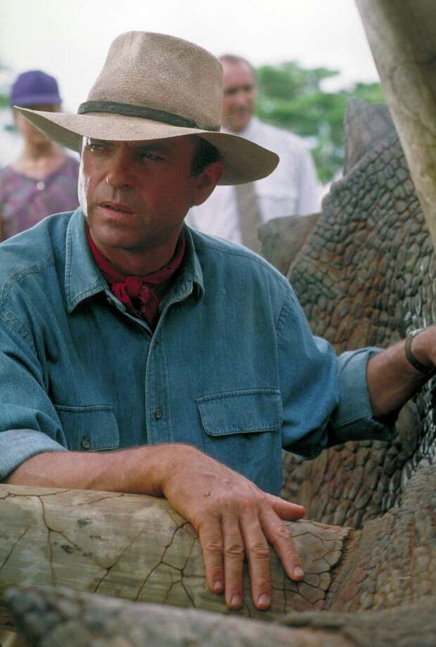 Actor Sam Neill as Dr. Alan Grant, tending to a sick Triceratops in a scene from the film 'Jurassic Park.' Photo: Murray Close, Getty Images / 2011 Murray Close