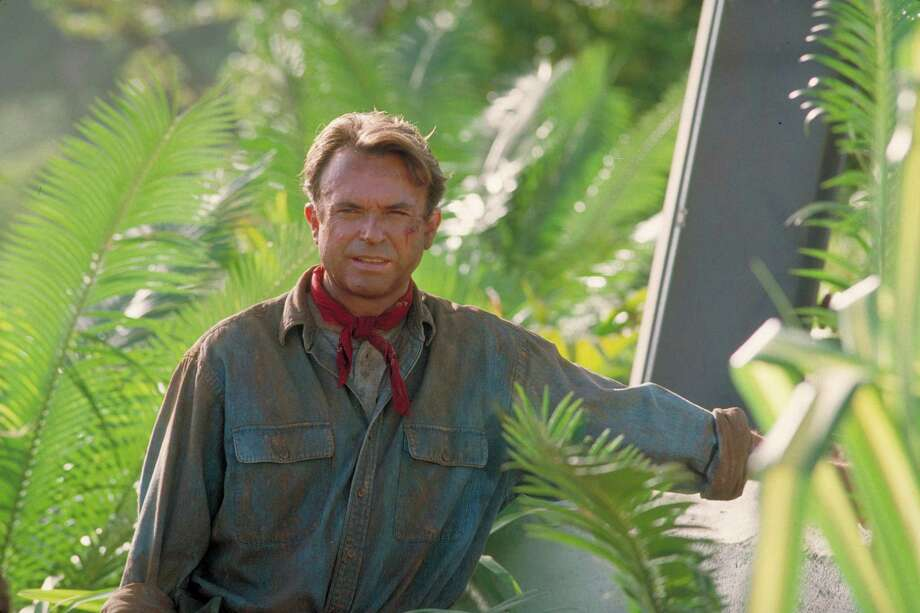 Actor Sam Neill as Dr. Alan Grant, standing next to an electric fence in a scene from the film 'Jurassic Park.' Photo: Murray Close, Getty Images / 2011 Murray Close