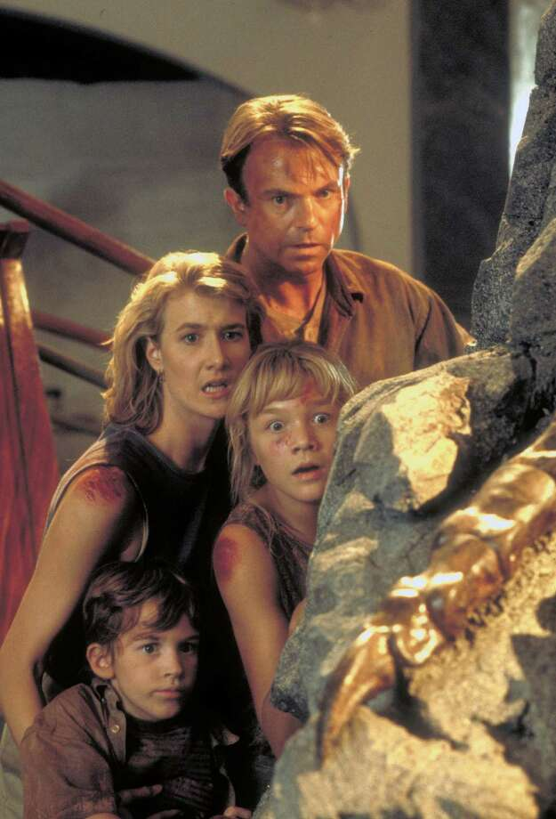 Actor Sam Neill as Dr. Alan Grant and actress Laura Dern as Dr. Ellie Sattler, with Ariana Richards (right) and Joseph Mazzello (left) as Lex and Tim, in a scene from the film 'Jurassic Park.' Photo: Murray Close, Getty Images / 2011 Murray Close