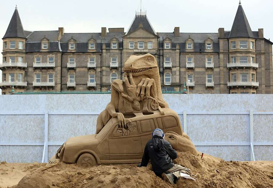 A sculptor works on a Jurassic Park themed sand creation for the Hollywood themed annual Weston-super-Mare Sand Sculpture festival on March 26, 2013 in Weston-Super-Mare, England. Photo: Matt Cardy, Getty Images