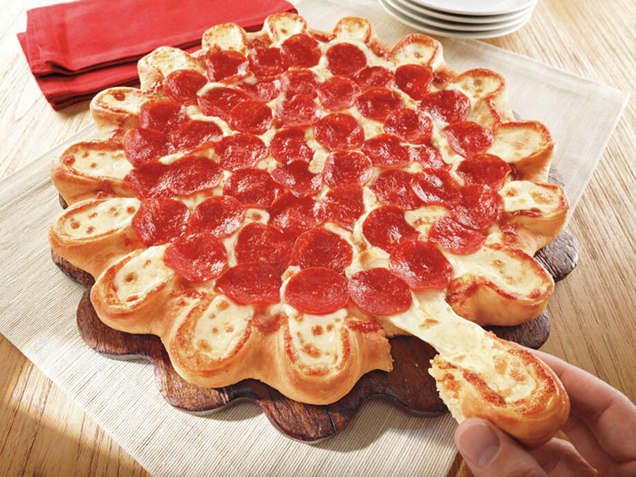 "This  undated product image provided by Pizza Hut shows the company's new pizza crust made of little cheese-stuffed bread bowls. The chain on Wednesday, April 3, 2013, is introducing a new pizza that comes surrounded by 16 semi-circles of cheese that can be pulled off and eaten separately. The ""Crazy Cheesy Crust,"" which will be available for several weeks, isn't the first time Pizza Hut has incorporated cheese into its crusts. (AP Photo/Pizza Hut_ Photo: AP"
