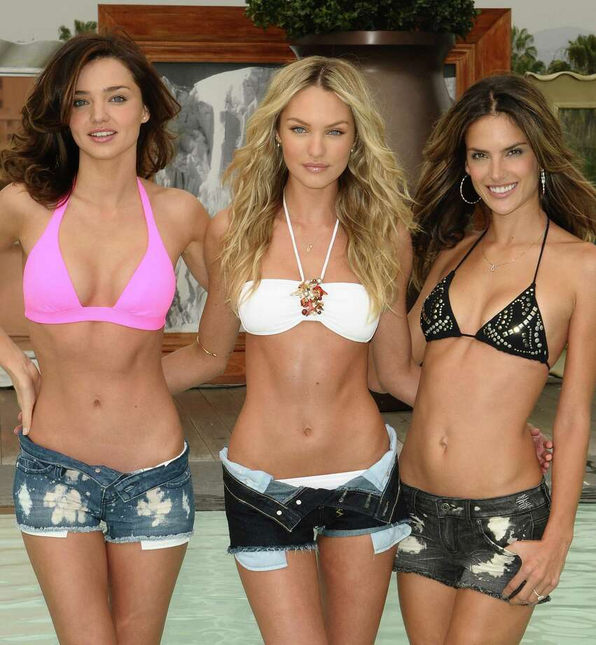 Miranda Kerr, Candice Swanepoel and Alessandra Ambrosio, Beverly Hills, 2010. Photo: Jason LaVeris, Getty Images / 2010 Jason LaVeris