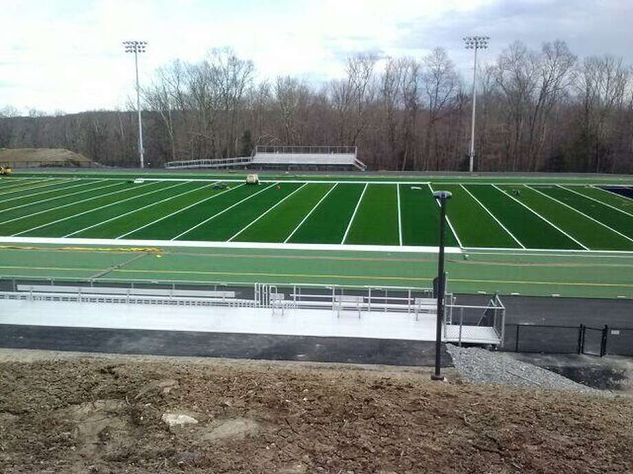 Oxford's new football field has had its synthetic turf laid down and bleachers erected. (Via Oxford Football)