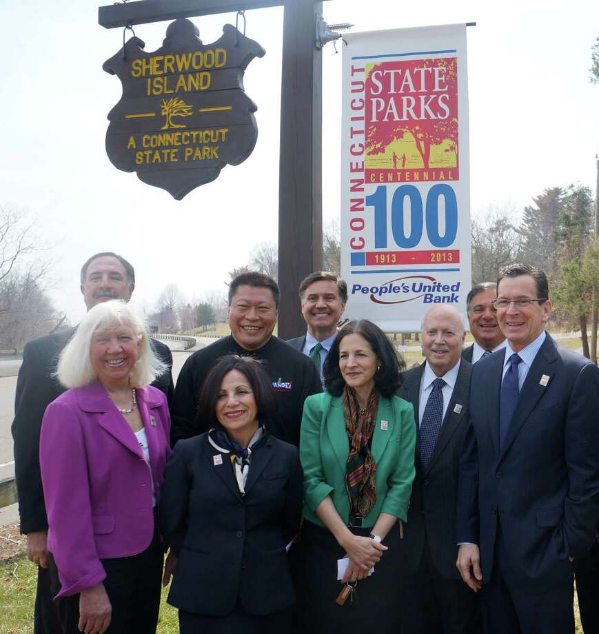 Officials gathered Monday at Sherwood Island State Park to kick off a centennial celebration of the state parks system. From left, are: Liz-Ann Koos, co-president of Friends of Sherwood Island State Park; state Rep. Jonathan Steinberg; state Rep. Tony Hwang; state Sen. Toni Boucher; Department of Energy and Environmental Protection Commissioner Daniel Esty, state Rep. Gail Lavielle, First Selectman Gordon Joseloff, People's United Bank executive vice president Robert D'Amor and Gov. Dannel P. Malloy. Photo: Paul Schott / Westport News
