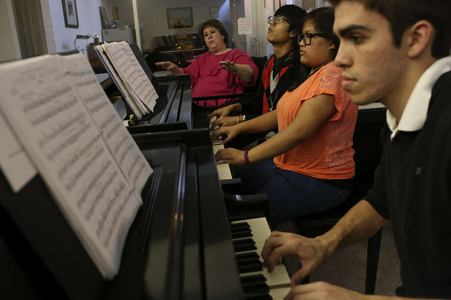 Piano teacher Linda Camann directs students Robbie Elefante, 16, (from left), Nicole Elefante, 14, and George Gillette, 17, as they practice for their upcoming Sunday concert at Buena Vista Street Theatre on the UTSA downtown campus. Photo: Photos By Lisa Krantz / San Antonio Express-News