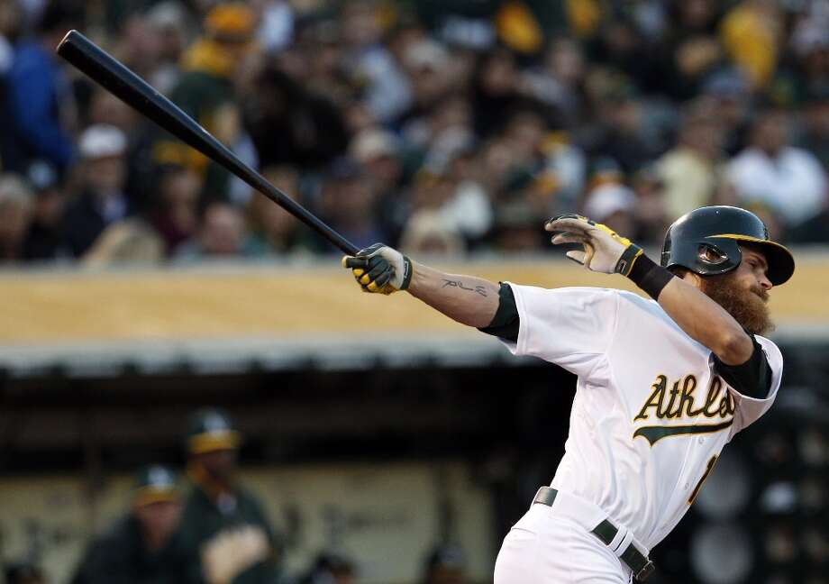 Josh Reddick swings through a pitch in the first inning and went 0-4 for the game. The Oakland Athletics played their 2013 home opener against the Seattle Mariners at O.co Coliseum in Oakland, Calif., on Monday, April 1, 2013. Photo: Carlos Avila Gonzalez, The Chronicle / ONLINE_YES