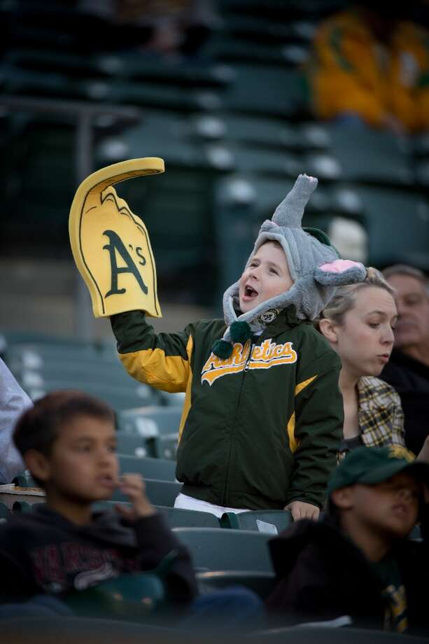 Five year-old Parker Taylor, of Vacaville, Calif., attended his fifth opening day on Monday, April 1, 2013 between the Oakland Athletics and Seattle Mariners in Oakland, Calif. Photo: Jose Luis Villegas, Associated Press / The Sacramento Bee