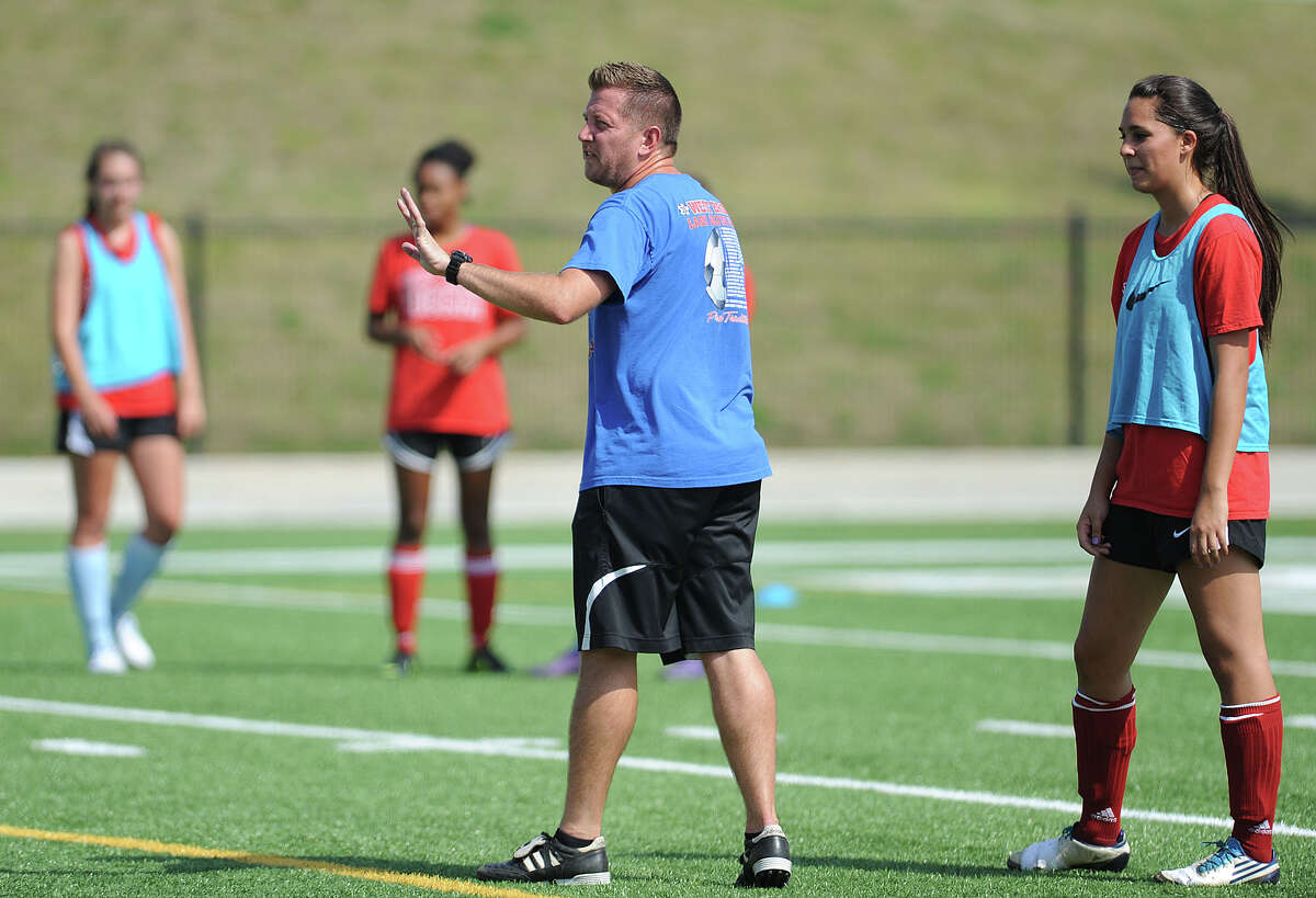West Brook's Josh Tanner directs the girls soccer team during practuce at the Carrol A.