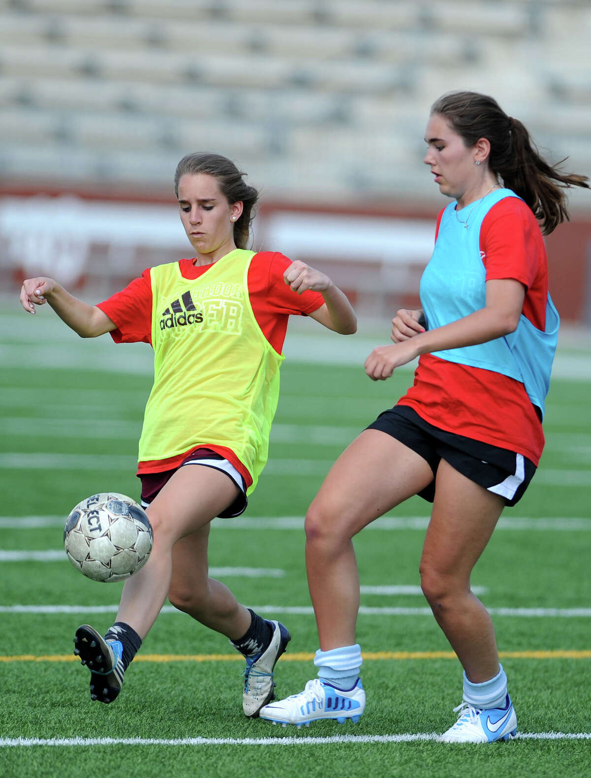 West Brook's Katharine Cox, left, drives the ball against Mechelle Falgout during practuce at the Carrol A.