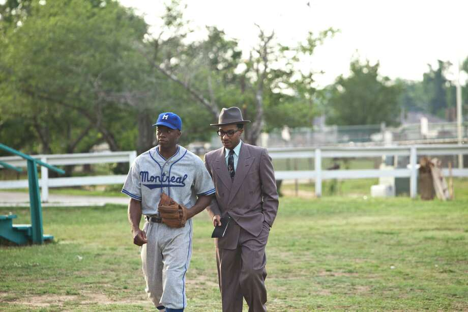 "Chadwick Boseman as Jackie Robinson and Andre Holland as Wendell Smith in ""42."" Photo: D. Stevens, Warner Brothers / © 2013 Legendary Pictures Productions LLC"