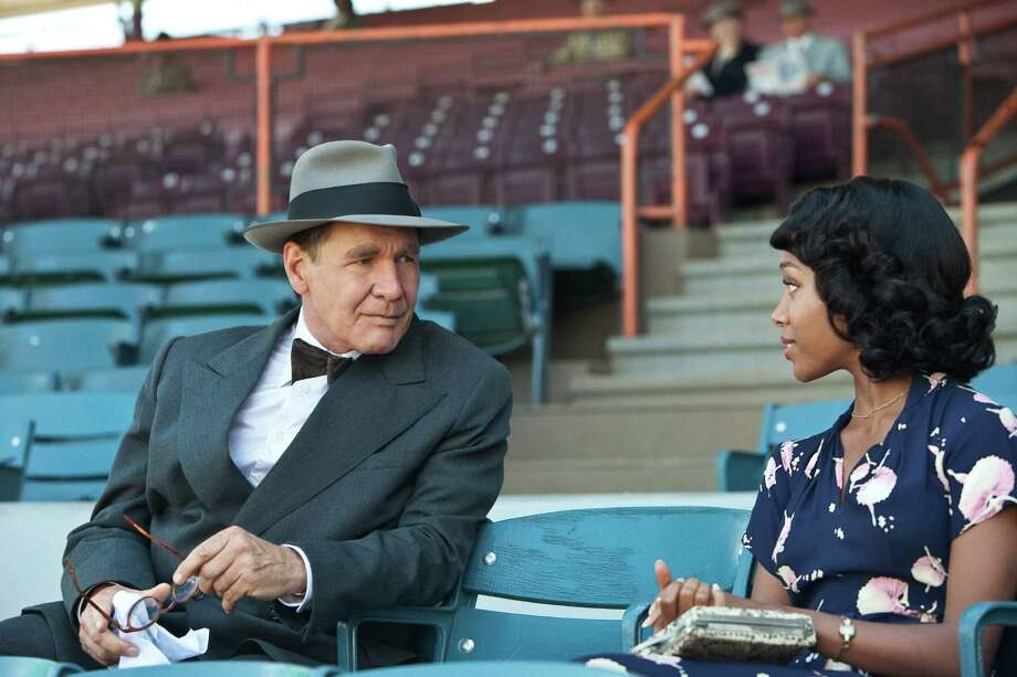 """Harrison Ford as Branch Rickey and Nicole Beharie as Rachel Robinson in """"42."""" Photo: D. Stevens, Warner Brothers / © 2013 Legendary Pictures Productions LLC"""